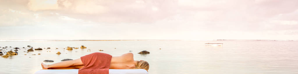 model on the beach at a hotel spa in Mauritius at sunrise