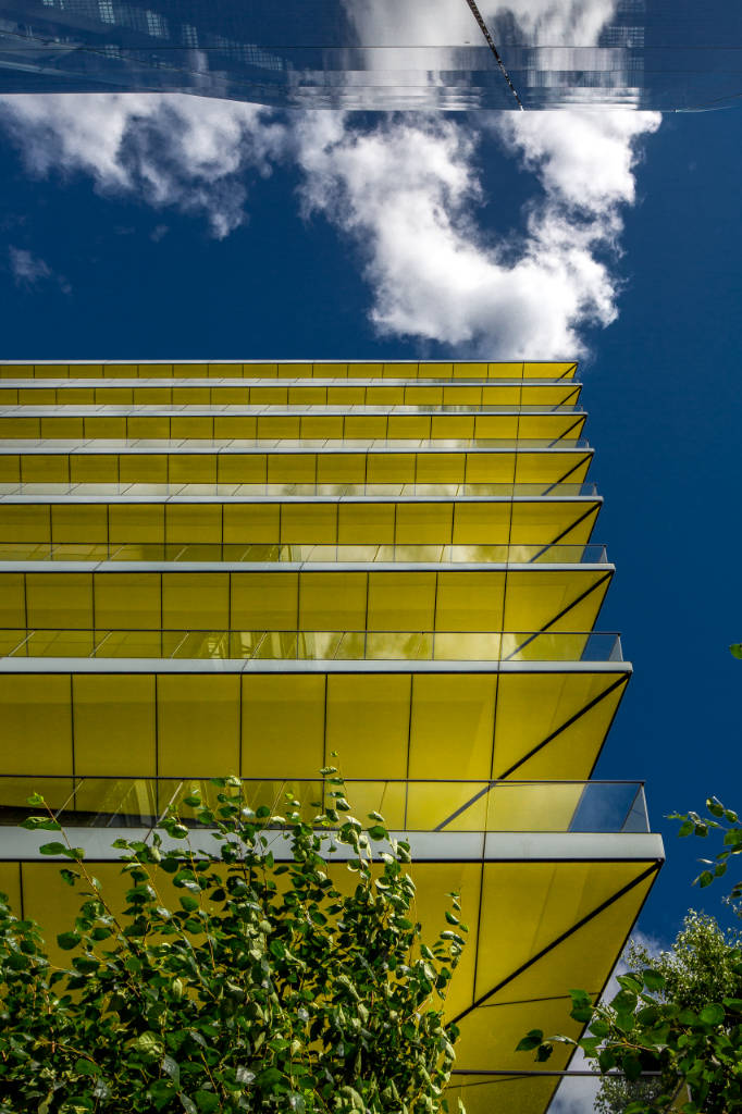Riverbank House in London yellow balcony building
