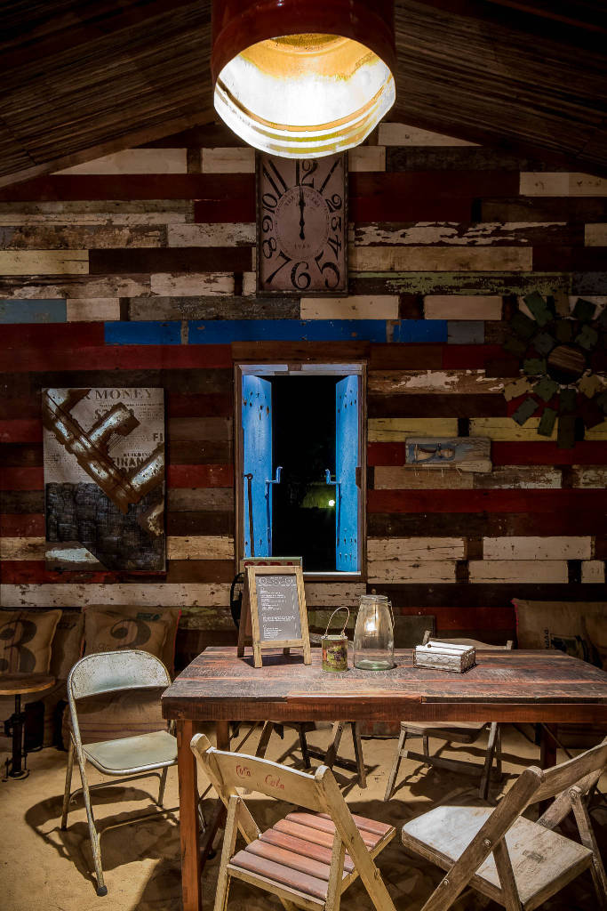 wood panelled Shanti Maurice Rum Shed bar in Mauritius blue window shutters