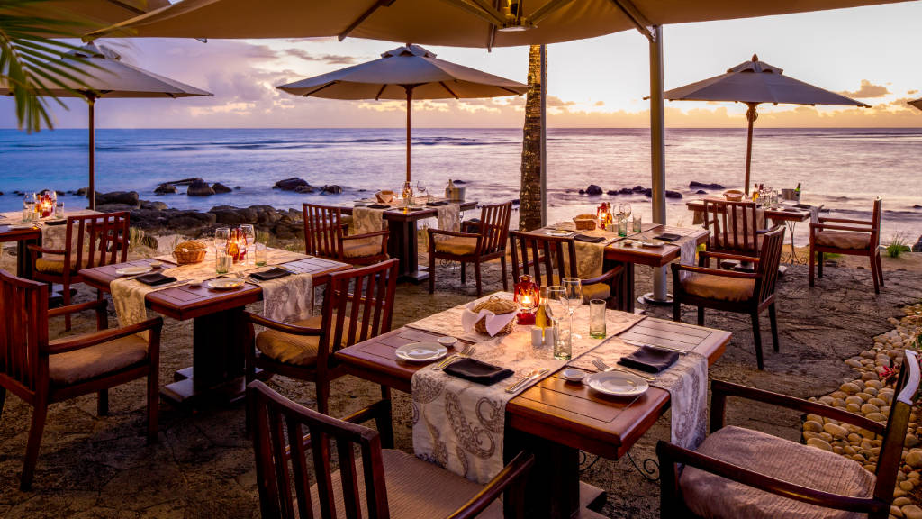 The Oberoi Mauritius On The Rocks restaurant at sunset