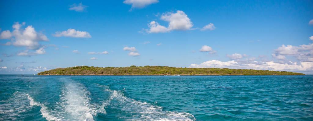 Coral island of Ile aux Aigrettes in Mauritius with blue sea and sky